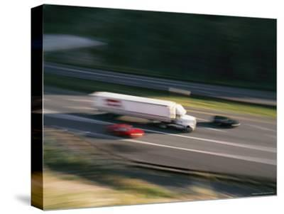 A Truck and Two Cars Barreling Down the Highway-Brian Gordon Green-Stretched Canvas Print