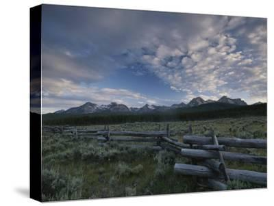 The Sawtooth Mountain Range is a Backdrop for a Split-Rail Fence-Michael Melford-Stretched Canvas Print
