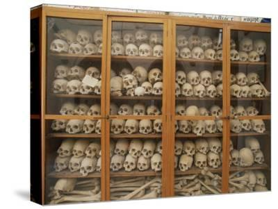 Human Skulls and Femurs Fill a Display Case at Nea Moni Monastery-Tino Soriano-Stretched Canvas Print