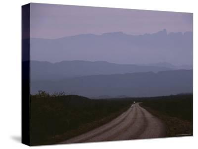 Twilight View of Road Leading to Fog-Shrouded Mountains-Medford Taylor-Stretched Canvas Print