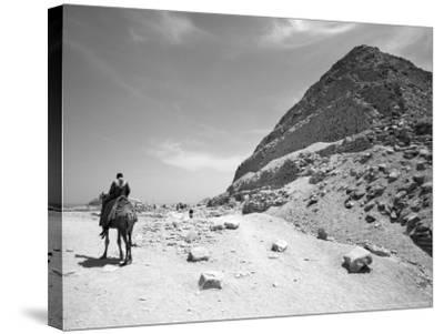 First Stepped Pyramid with Camel Rider, Egypt-David Clapp-Stretched Canvas Print