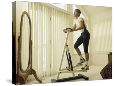 Low Angle View of a Woman Exercising--Stretched Canvas Print