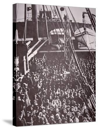 The Crowded Deck of an Immigrant Ship Entering New York Harbour, c.1905--Stretched Canvas Print