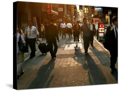 Japanese Commuters Walk Through a Tokyo Street on Their Way to the Train Stations-David Guttenfelder-Stretched Canvas Print