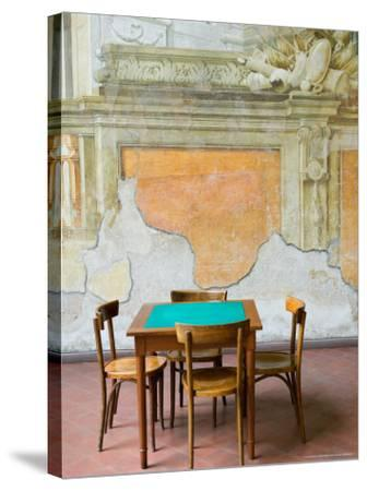 Table and Wall at 15th century Sedile Dominova Social Club, Sorrento, Campania, Italy-Walter Bibikow-Stretched Canvas Print