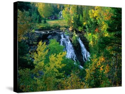 Waterfall and Autumn Colours with House in Background, Silver River Falls, Keweenaw County, USA-Charles Cook-Stretched Canvas Print