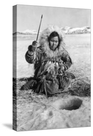 Eskimo Woman Fishing through Ice in Alaska Photograph - Alaska-Lantern Press-Stretched Canvas Print