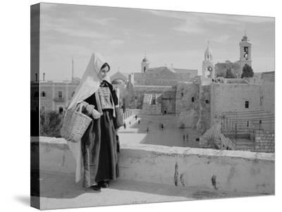 Woman on Roof Facing Church of the Nativity Photograph - Bethlehem, Palestine-Lantern Press-Stretched Canvas Print