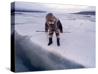 An Inuit Hunter Waits For Seals on an Ice Floe-Gordon Wiltsie-Stretched Canvas Print