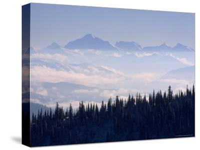 Clouds Envelope the Rocky Mountains Near Whitefish-Gordon Wiltsie-Stretched Canvas Print