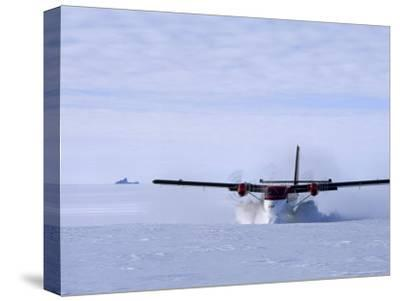 Twin Otter Departs From Base Camp Below the Rakekniven Spire-Gordon Wiltsie-Stretched Canvas Print
