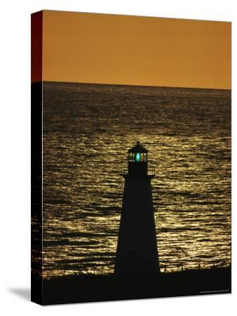 Illuminated Silhouetted Lighthouse at Sunset-Michael Melford-Stretched Canvas Print