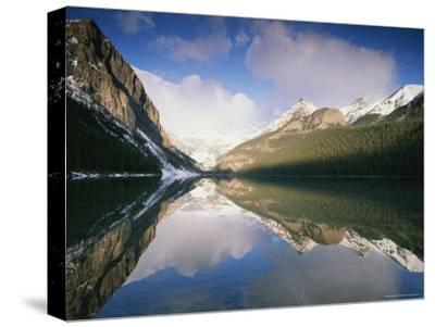View at Sunrise of Mountains Reflected on the Surface of Lake Louise-Rich Reid-Stretched Canvas Print