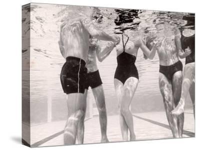 Underwater Shot of Actress Daphne Dayle in Topless, One Piece Swim Suit by Designer Ruben Torres-Paul Schutzer-Stretched Canvas Print