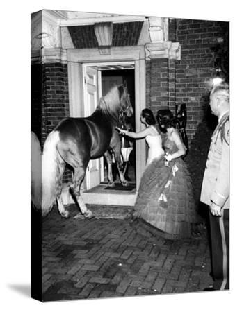 People Bringing in Horse at Dwight D. Eisenhower's Inauguration Party-Cornell Capa-Stretched Canvas Print