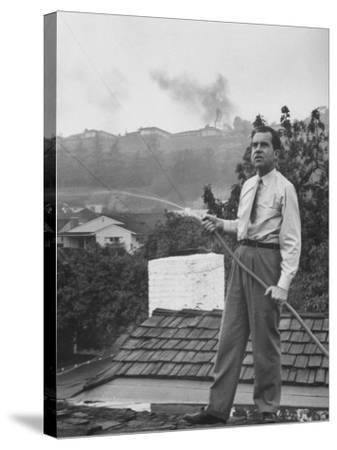 Senator Richard M. Nixon on Roof of Home in Los Angeles, Putting Out Fires Caused by Brush Blaze-Allan Grant-Stretched Canvas Print