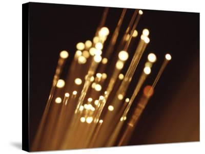 Ends of Fiber Optic Cables with Bright Lights--Stretched Canvas Print