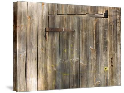 Weathered Wooden Door and Wall with Rusted Brass Hinge--Stretched Canvas Print