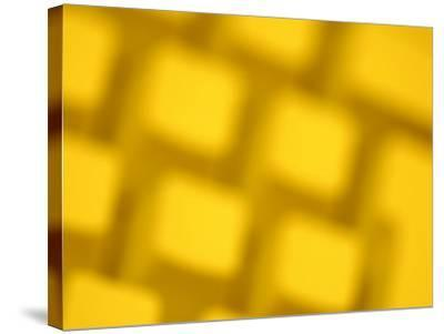 Unfocused Yellow Tinted Computer Keyboard--Stretched Canvas Print