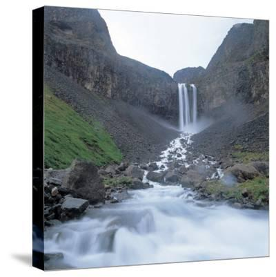 Rushing and Cascading Waterfall Between Mountains--Stretched Canvas Print