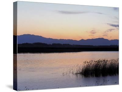 Sunset over a Peaceful Lake with Silhouette of Mountains--Stretched Canvas Print