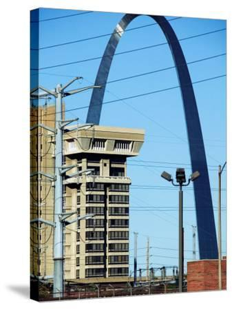 Historical Gateway Arch Towering over Building in St. Louis, Missouri--Stretched Canvas Print