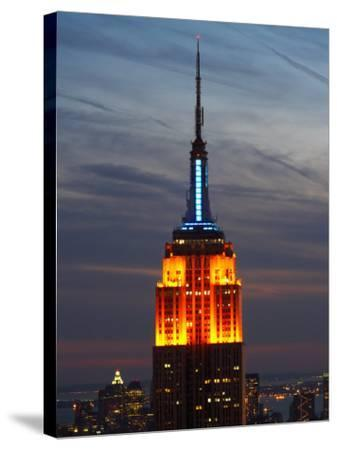 Top of the Empire State Building Illuminated at Night in New York City, New York--Stretched Canvas Print