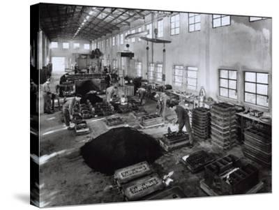 Inside of a Ferrari Factory with Some Workers-A^ Villani-Stretched Canvas Print