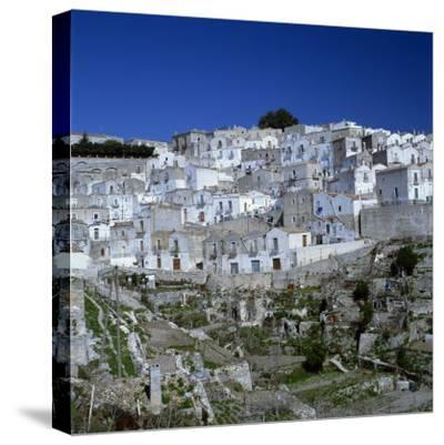 Houses of the Village of Monte Sant Angelo in Puglia, Italy, Europe-Tony Gervis-Stretched Canvas Print