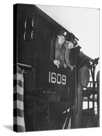 Col. Ryan and Major General Mcmullen Looking Out the Cab of a New Locomotive--Stretched Canvas Print