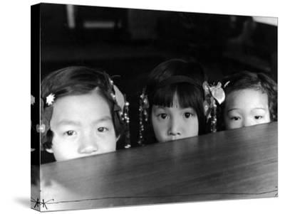 Little Girls Peeking over Rim of Table at California Chinese Mission School-Alfred Eisenstaedt-Stretched Canvas Print