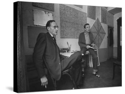 Painter Brion Gysin, Shown W His Paintings in Hotel Room in with Writer William S. Burroughs-Loomis Dean-Stretched Canvas Print