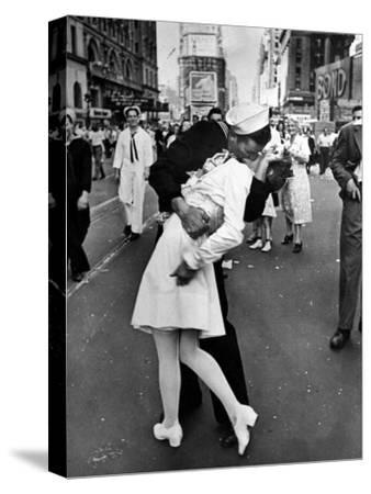American Sailor Clutching a White-Uniformed Nurse in a Passionate Kiss in Times Square-Alfred Eisenstaedt-Stretched Canvas Print