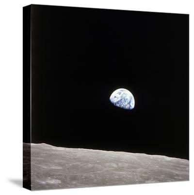 Apollo 8 View of Earth Rise over the Moon--Stretched Canvas Print