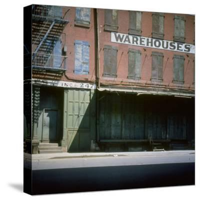 Shuttered Warehouse on the Lower East Side Lit by Late Day Sunlight--Stretched Canvas Print