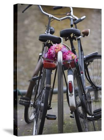 Two Bicycles with a Flower Chain, Amsterdam, Netherlands, Europe-Amanda Hall-Stretched Canvas Print