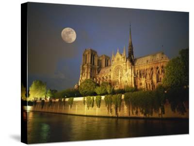 Notre Dame Cathedral at Night, with Moon Rising Above, Paris, France, Europe-Howell Michael-Stretched Canvas Print