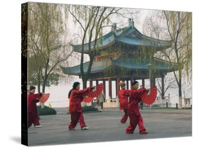 Women Practising Tai Chi in Front of a Pavilion on West Lake, Hangzhou, Zhejiang Province, China-Kober Christian-Stretched Canvas Print
