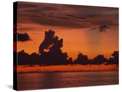 Tropical Sunset Off Seven Mile Beach, Cayman Islands, West Indies, Central America-Tomlinson Ruth-Stretched Canvas Print