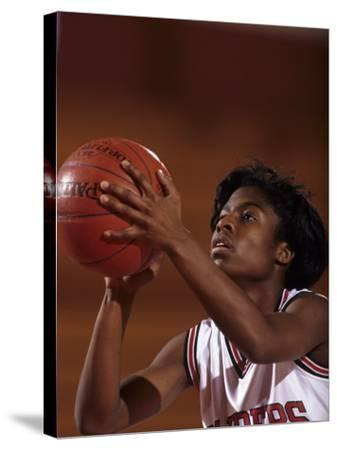 Female High Schooll Basketball Player in Action Shooting a Free Throw During a Game--Stretched Canvas Print
