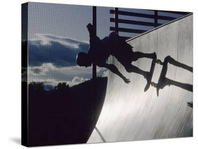 Skateboarder in Action on the Vert--Stretched Canvas Print