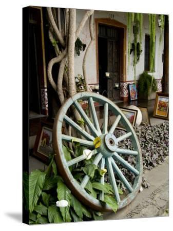 Wagon Wheel, La Posada De Don Rodrigo Hotel, Antigua, Guatemala-Bill Bachmann-Stretched Canvas Print