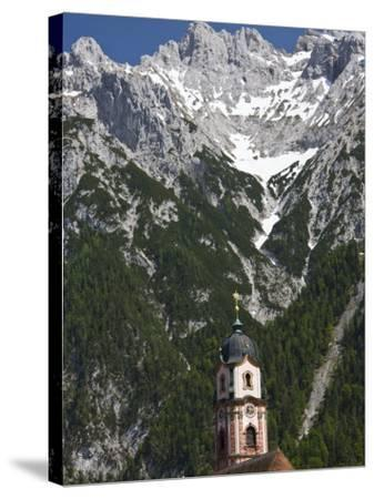 Town church and mountains, Mittenwald, Bayern-Bavaria, Germany-Walter Bibikow-Stretched Canvas Print