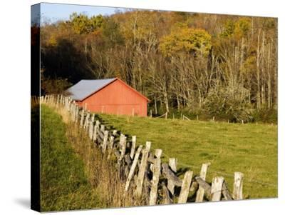 Red Barn and Fence along the Blue Ridge Parkway, Blowing Rock, North Carolina, USA-Chuck Haney-Stretched Canvas Print