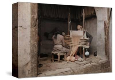 Two People Work on a Handloom in a Weaving Capital, Damascus-Gervais Courtellemont-Stretched Canvas Print