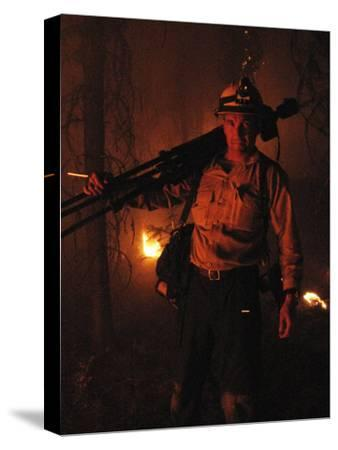 Photographer on Assignment Covering Forest Fires-Mark Thiessen-Stretched Canvas Print