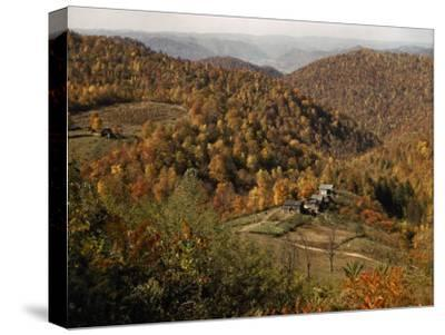 Scenic View of Farms Settled in a West Virginia Hillside Forest-B^ Anthony Stewart-Stretched Canvas Print