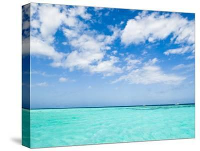 Cloud-Filled Sky and Clear Blue Waters of Ambergris Cay-James Forte-Stretched Canvas Print