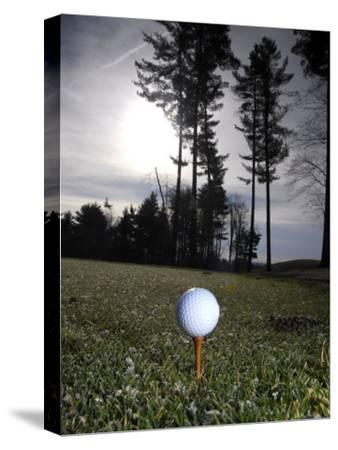 Golf Ball on a Tee at Twilight-Raul Touzon-Stretched Canvas Print