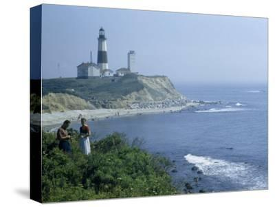 People Stand on Point across Bay from Montauk Point Light-B^ Anthony Stewart-Stretched Canvas Print